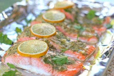 Salmon fillets covered in herb and lemon