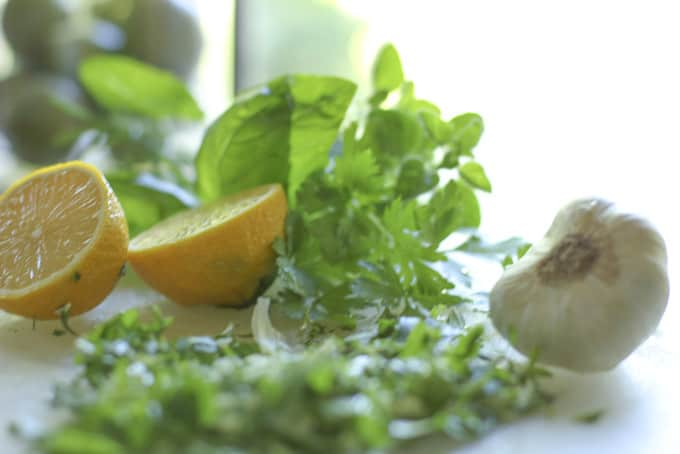 Fresh herbs with lemon and garlic
