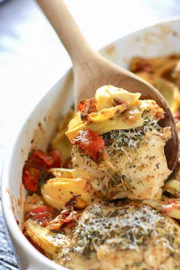 Italian chicken bake with artichokes and tomatoes italian chicken being served from casserole dish forumfinder
