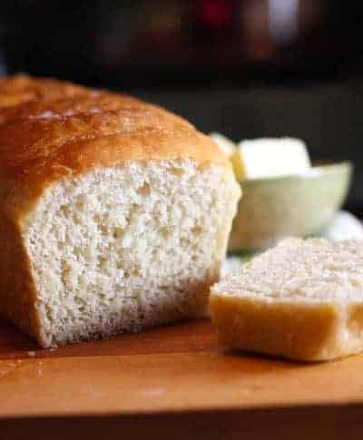 Warm English Muffin Bread sliced and served with butter