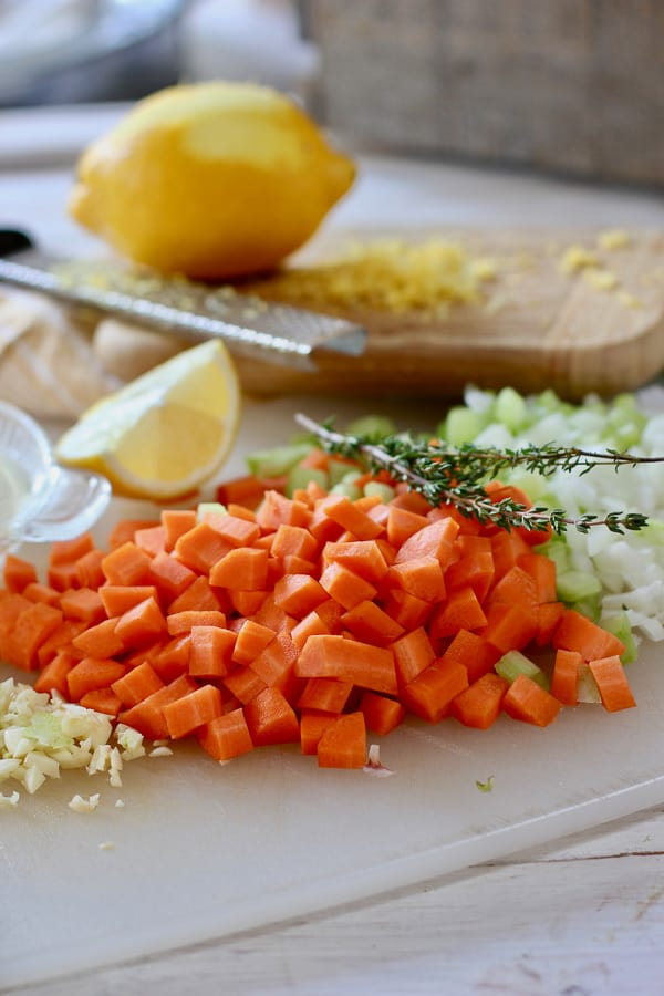 mirepoix, fresh time and lemon on a cutting board