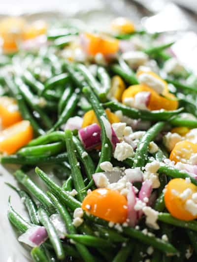 Crisp Bean Salad with a simple vinaigrette.  Chilled and topped with feta!  A nice change up from your everyday lettuce salad. #greenbeans #beansalad