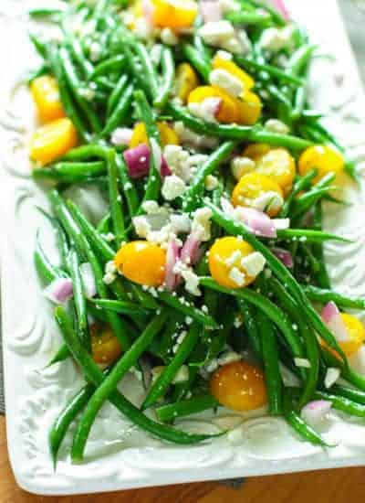 Bean Salad on a beautiful white platter with feta sprinkled on top