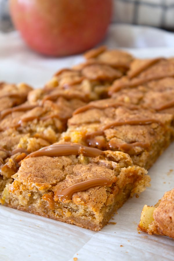 apple bars on a sheet of parchment paper