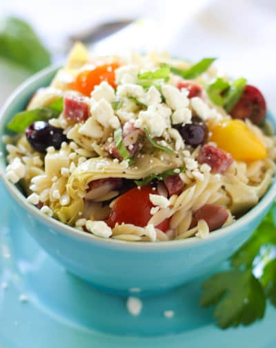 Orzo Pasta Salad served in a blue bowl