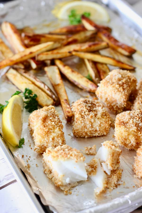 fish and chips on a baking sheet
