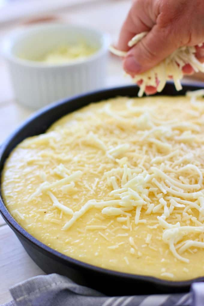 sprinkle polenta pie with more cheese