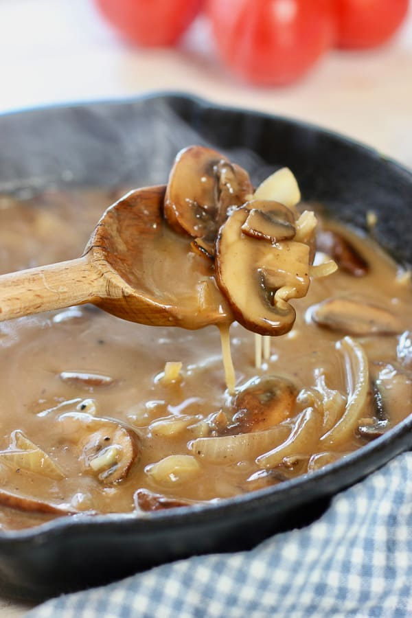 mushroom and onion gravy in cast iron skillet