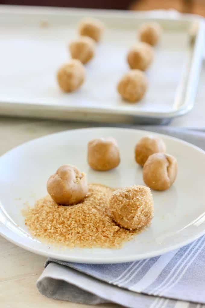 roll peanut butter cookies in turbinado sugar