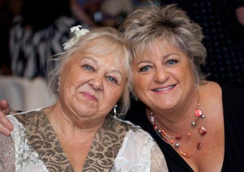 me and my mom at my nieces wedding