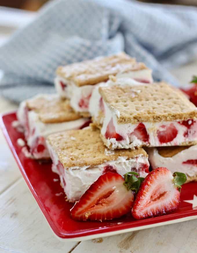 strawberry frozen yogurt treats on a red plate