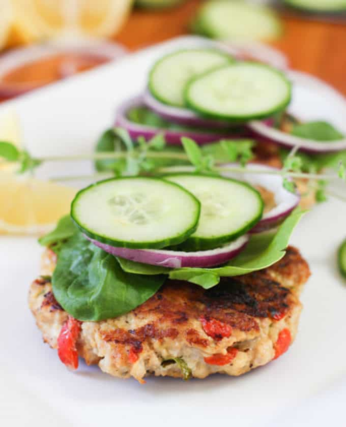 burgers topped with cucumber and spinach