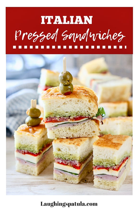 These Italian Pressed Sandwiches are stuffed with salami, ham, cheese and roasted red peppers. Pressed overnight and served as appetizers or lunch! #picnicfood #partyfood #foodforacrowd #appetizersforacrowd #appetizer