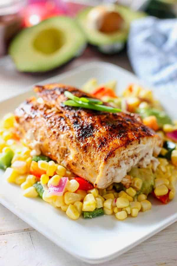 fresh mahi on top of corn salad