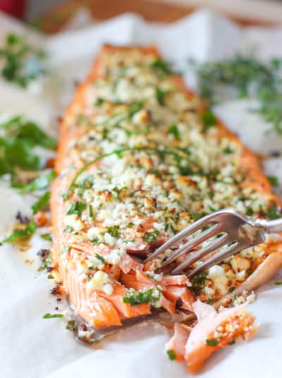 salmon on a sheet pan with a fork