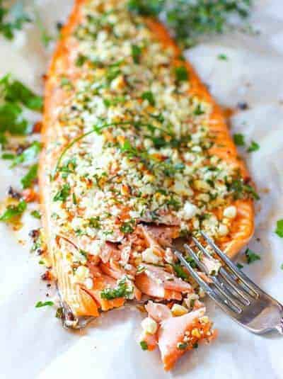 salmon crusted with herbs and feta on a sheet pan