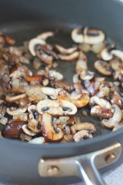 mushrooms browning in large skillet