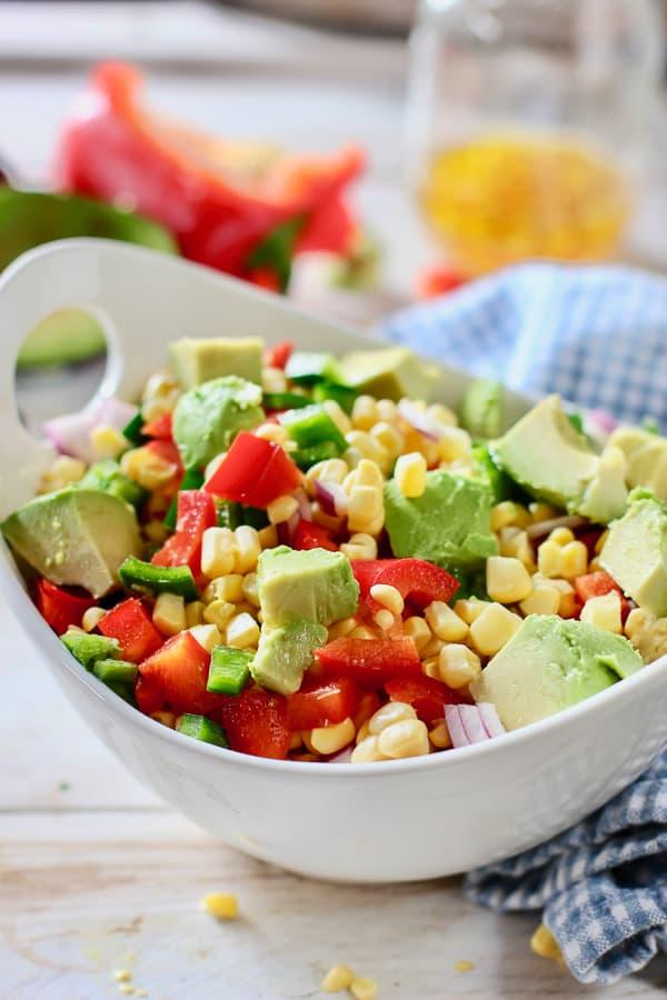Fresh corn salad in a white bowl