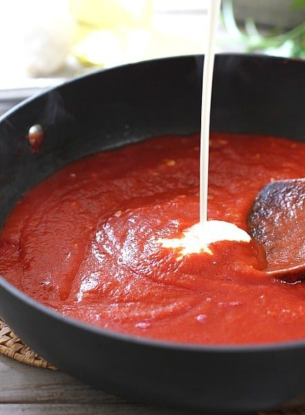 Adding cream to simple tomato sauce