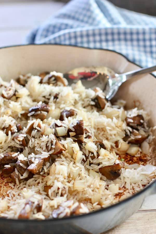 rice and mushrooms browning in skillet