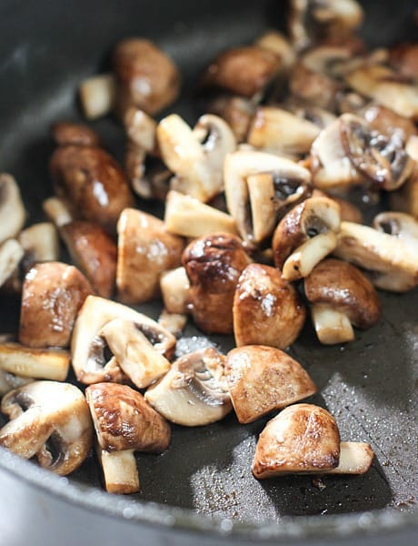 mushrooms sizzling in pan