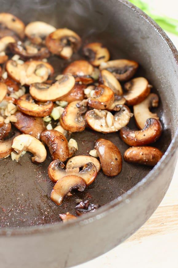 perfectly browned mushrooms in black skillet