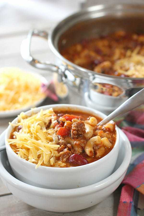 Chili Mac Soup in a bowl with a pot