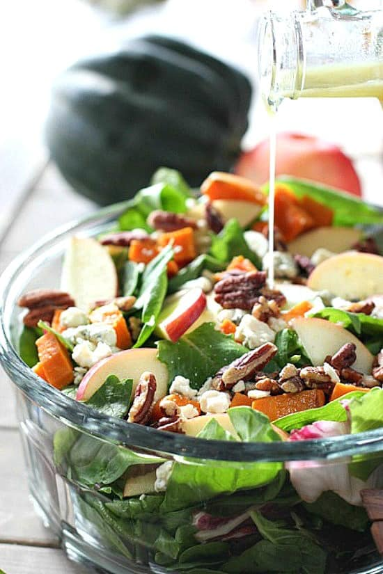 Fall salad in a bowl with dressing