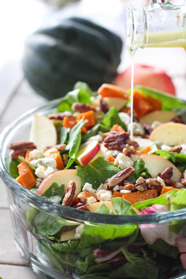 beautiful fall salad in clear bowl