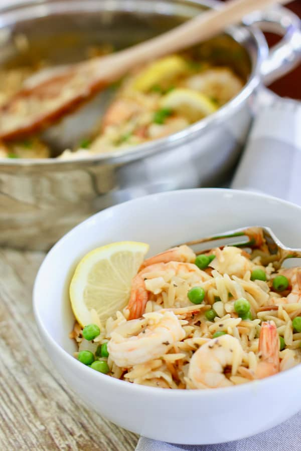 shrimp and orzo dinner in white bowl