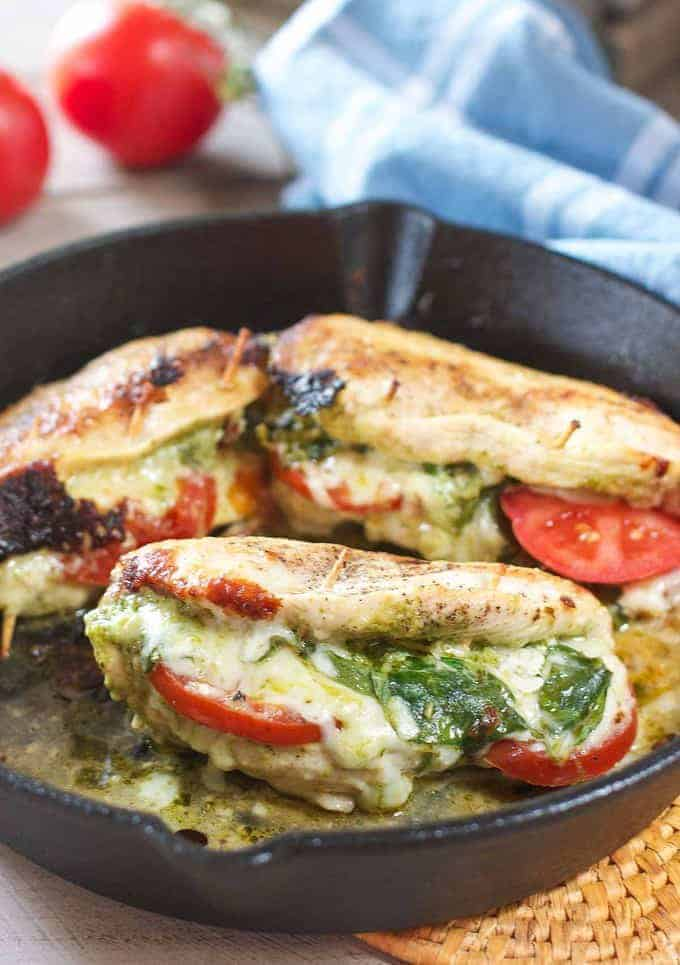 stuffed chicken breasts in a cast iron skillet