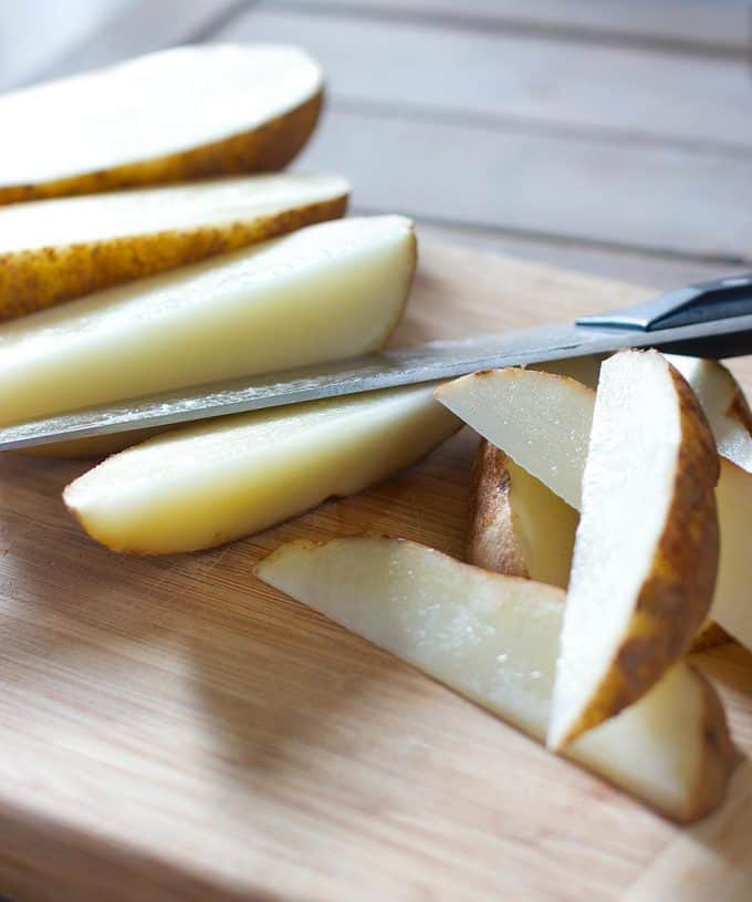 Baked Parmesan and Garlic Potato Wedges | Laughing Spatula