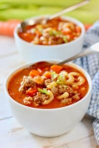 minestrone sauste soup in white bowls
