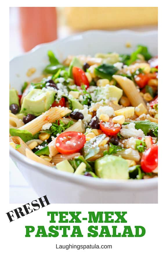 This Tex Mex pasta Salad with Chili Tomato Vinaigrette is made with fresh crunch corn, black beans, avocado and tossed in an easy vinaigrette #saladforacrowd #texmex #pastasalad #easypastasalad #healthypastasalad