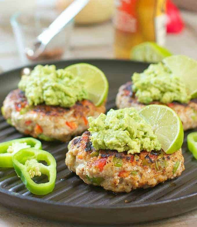 Chili Lime Burgers with Avocado Salsa on a grill pan