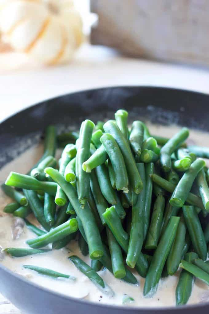 Green Beans being tossed in cream sauce