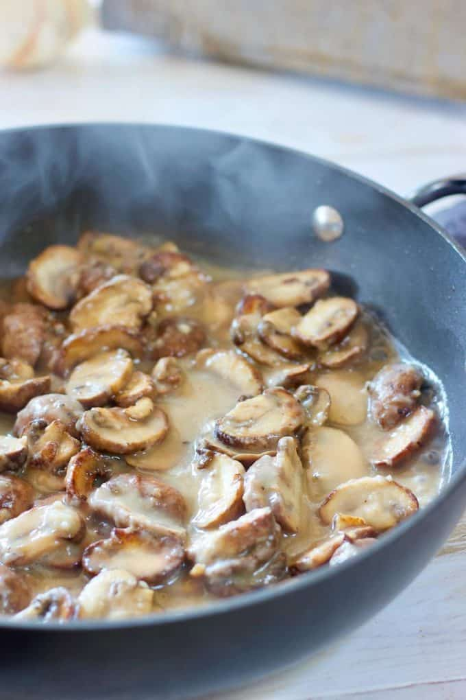 Saute mushrooms in a skillet