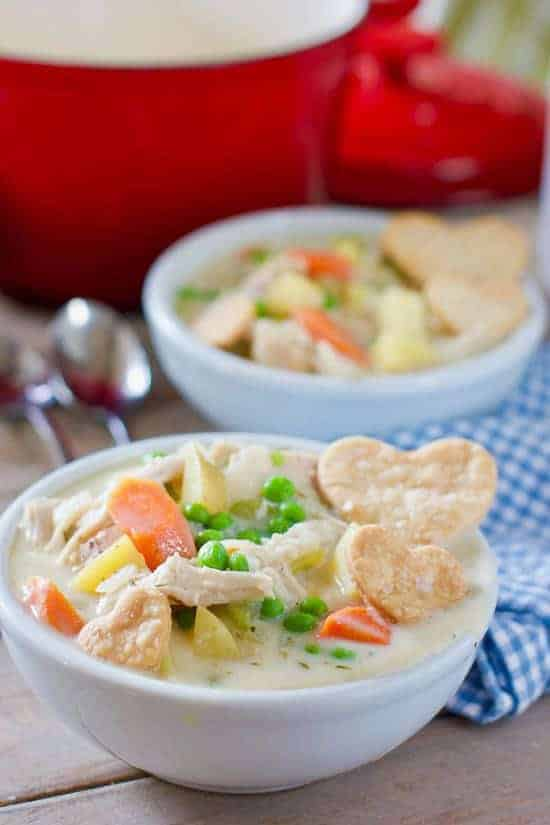 Chicken Pot Pie Soup in a bowl with pastry hearts