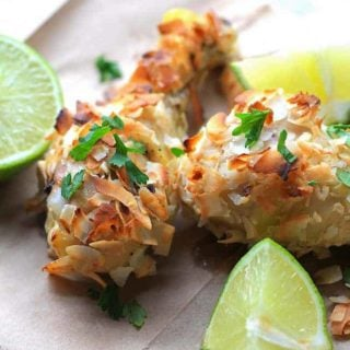 Coconut and Lime Chicken Drumsticks with lime and cilantro garnish