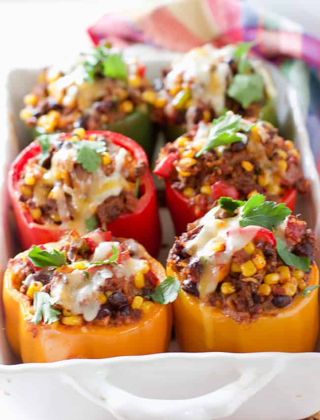 Stuffed peppers in a white casserole dish