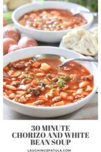 chorizo and white bean soup in large white bowls