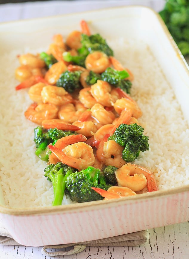 Shrimp and Broccoli Stir Fry served in a pink casserole dish