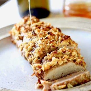 brown sugar pork loin on a plate with honey drizzle