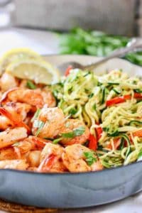 Shrimp and Zucchini noodles in a blue cast iron pan