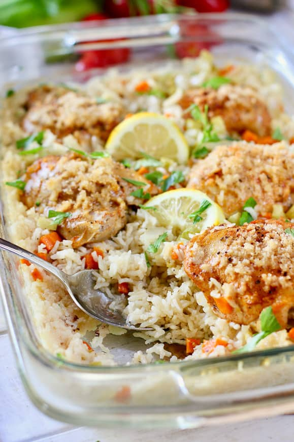 chicken and rice in a clear casserole dish