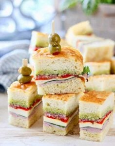 Pressed Italian Sandwiches stacked up on a platter