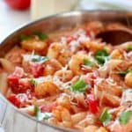 Creamy shrimp in tomato sauce in a large skillet