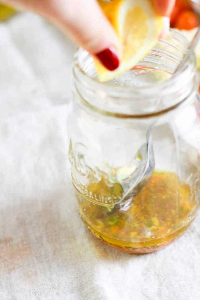 mixing dressing in mason jar