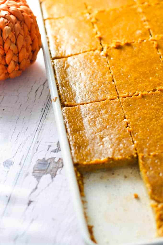 pumpkin pie on a sheet pan with square cut out