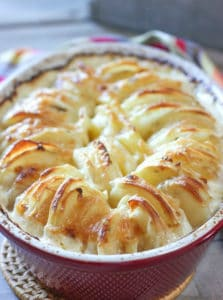 Cheesey Au Gratin Potatoes in a red casserole